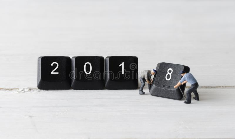 2018 new year concepts. Miniature people worker teamwork holding computer keyboard button 2018 new year concepts royalty free stock photography