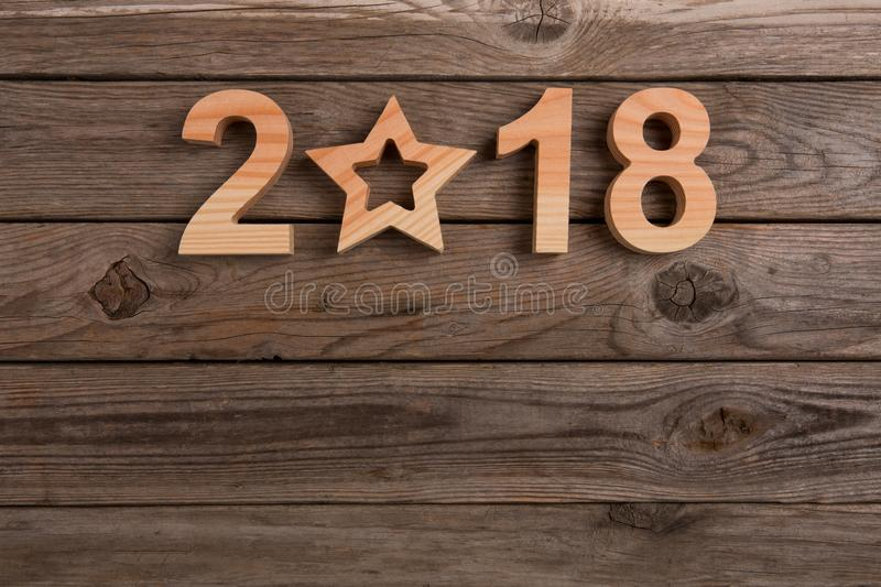 New year concepts 2018 on wood. New year working stock image