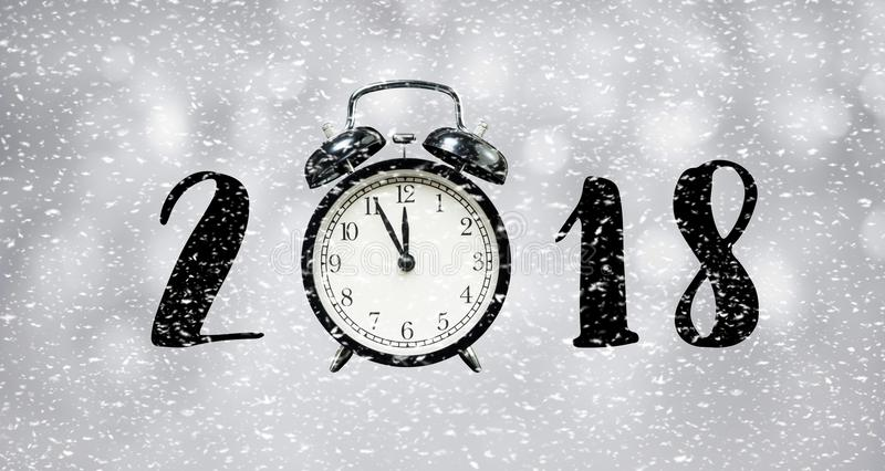 2018 new year countdown concept with time clock and snowfall stock photos