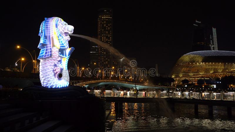 New Year Countdown 2019 at Merlion with colorful lights in Downtown Singapore City at night with skyscraper buildings background royalty free stock images