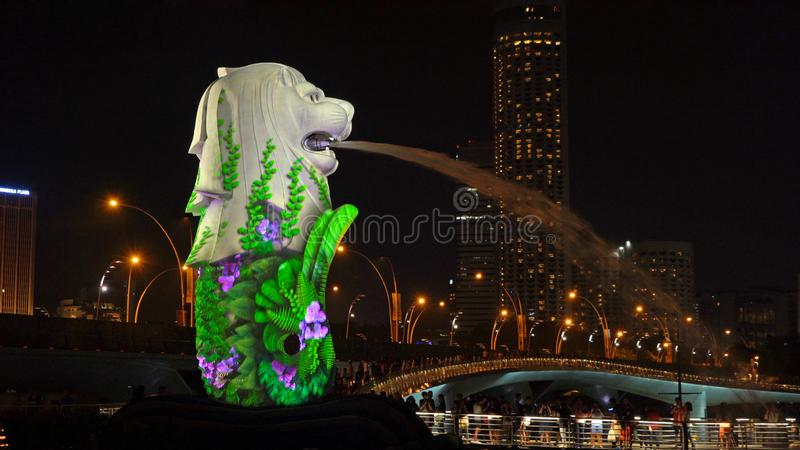 New Year Countdown 2019 at Merlion with colorful lights in Downtown Singapore City at night with skyscraper buildings background royalty free stock photo