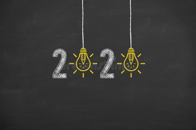 New Year 2020 Creative Idea Concepts on Blackboard Background. New year concepts stock images