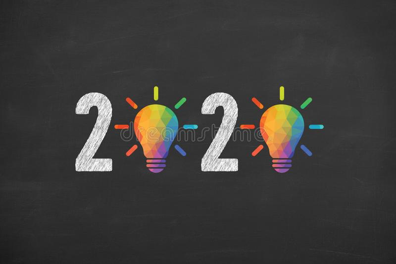 New Year 2020 Creative Idea Concepts on Blackboard Background. New year concepts stock photo