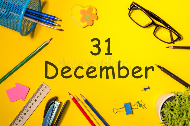 New year. December 31st. Day 31 of december month. Calendar on yellow businessman workplace background. Winter time royalty free stock photography