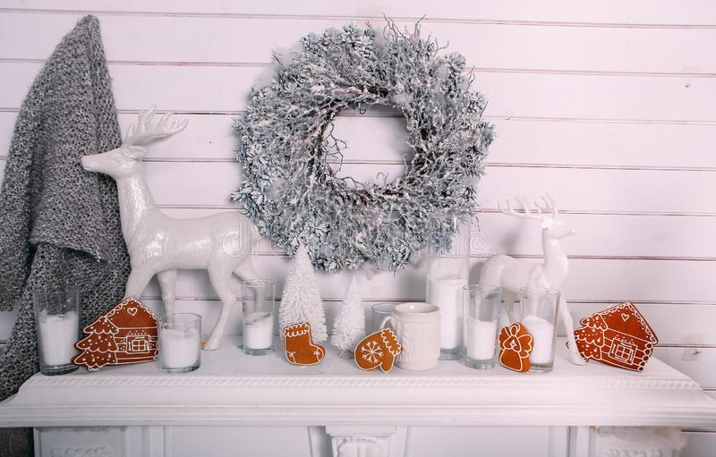 New Year white fireplace wreath Christmas gingerbread cookies royalty free stock photo