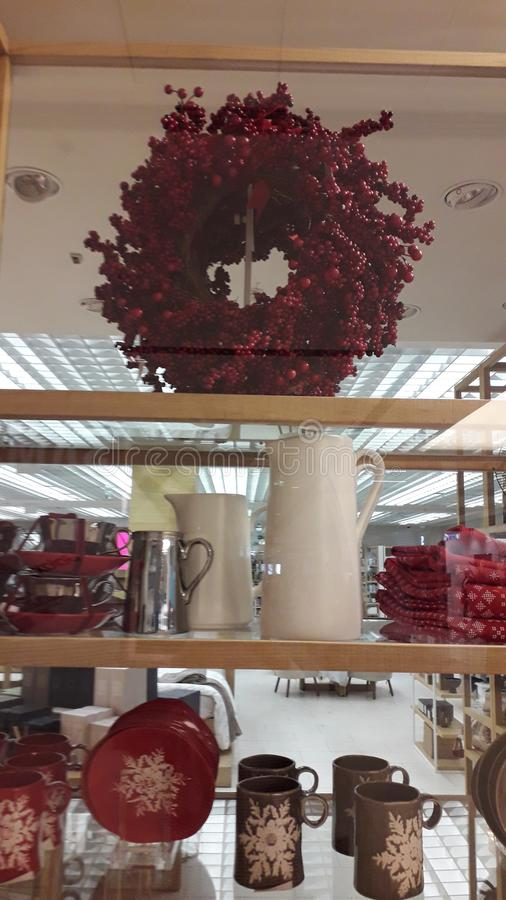 New Year decoration with branches, vases and couples store window in shoping mall Usce, New Belgrade. New Year decoration with branches, vases and red candles in royalty free stock photos