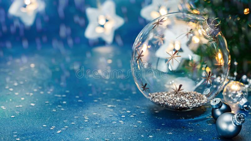 New year decorations. glass christmas tree balls on blurred star lights garland background royalty free stock photos
