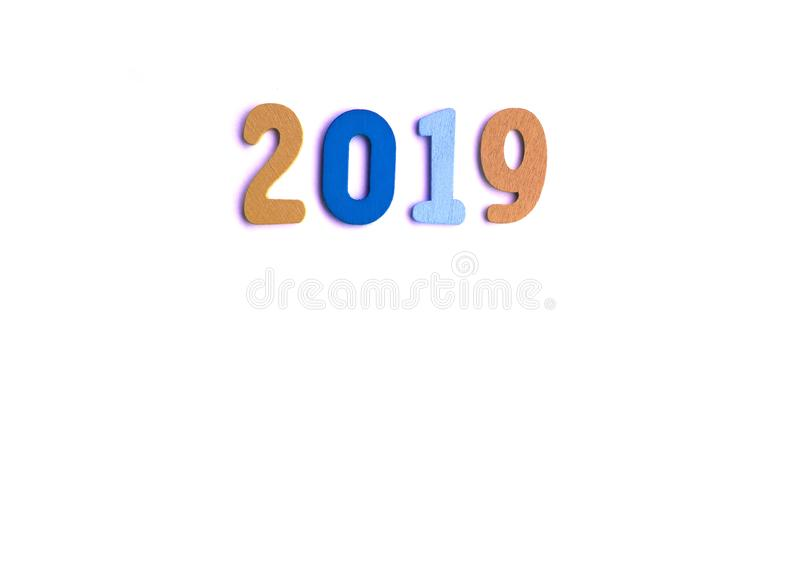 New Year decorative composition with 2019 colorful wooden small numbers. Festive card with empty space for message.  stock image