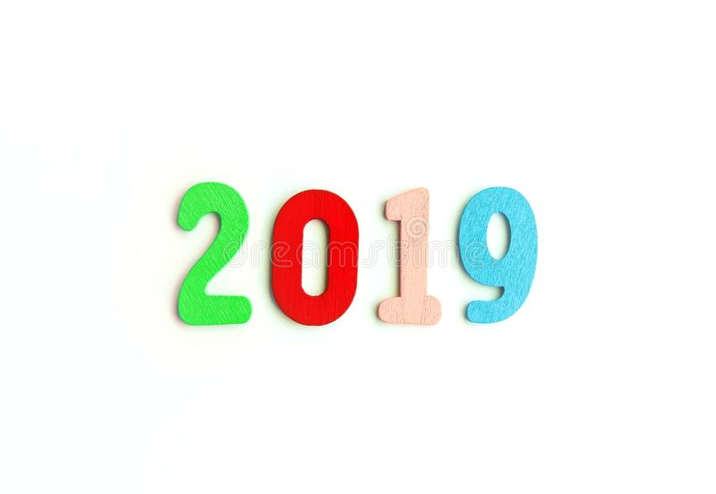 New Year decorative composition with 2019 colorful wooden small numbers. Festive card with empty space for message.  stock photos