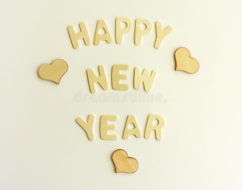 New Year decorative composition with letters and hearts. New Year decorative composition with letters and small hearts. Happy New Year festive card royalty free stock photo
