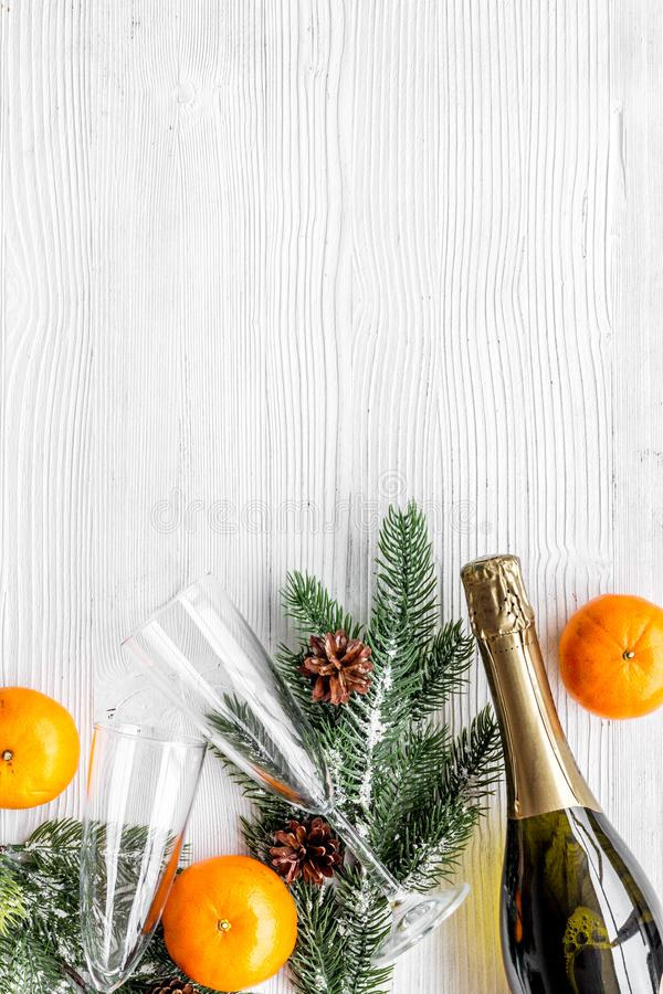 New year 2018 design with spruce, tangerine, champagne bottle and glasses on white table background top view space for. New year 2018 design with spruce branch stock photo