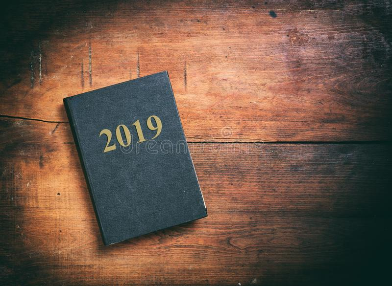 New year 2019 diary on wooden background, top view, copy space stock images
