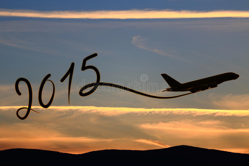New year 2015 drawing. By airplane on the air at sunset royalty free stock images
