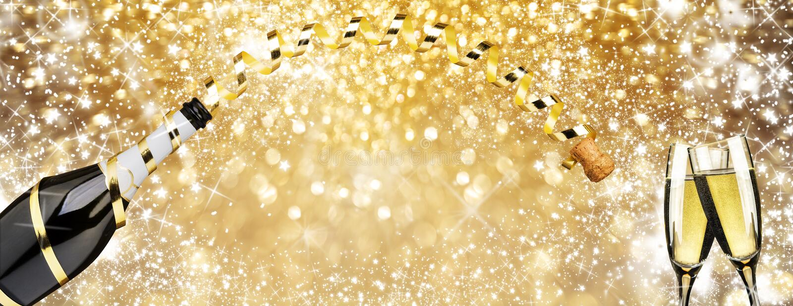 New year` eve toast champagne flutes , golden ribbon and fireworks sparkle golden background royalty free stock photo