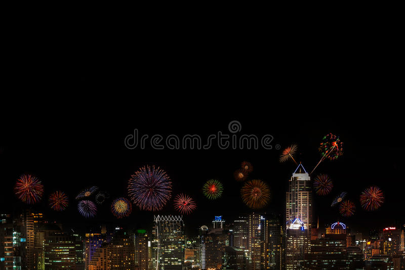 2015 New Year Fireworks celebrating over city at night. royalty free stock photography