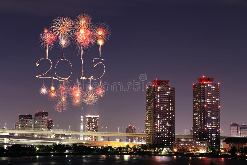 2015 New Year Fireworks celebrating over Tokyo cityscape. At night, Japan royalty free stock photo