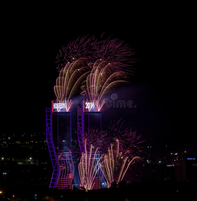 New Year Fireworks. Fireworks exploding over twin towers in Izmir, Turkey welcoming 2016 royalty free stock image