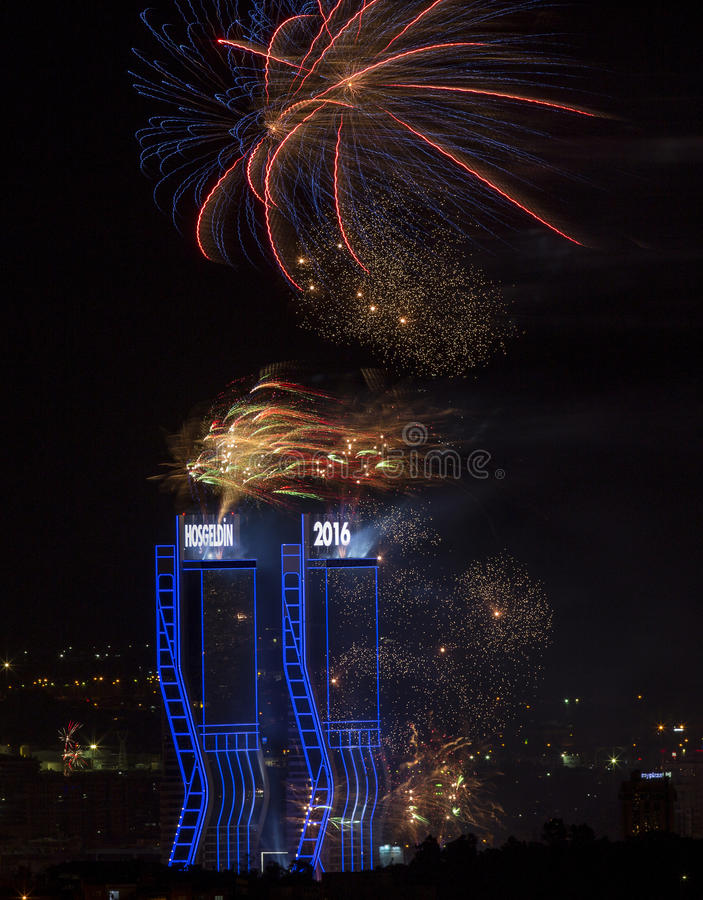 New Year Fireworks. Fireworks exploding over twin towers in Izmir, Turkey welcoming 2016 royalty free stock photography