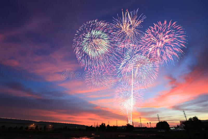 New year fireworks on twilight sky background. stock photos