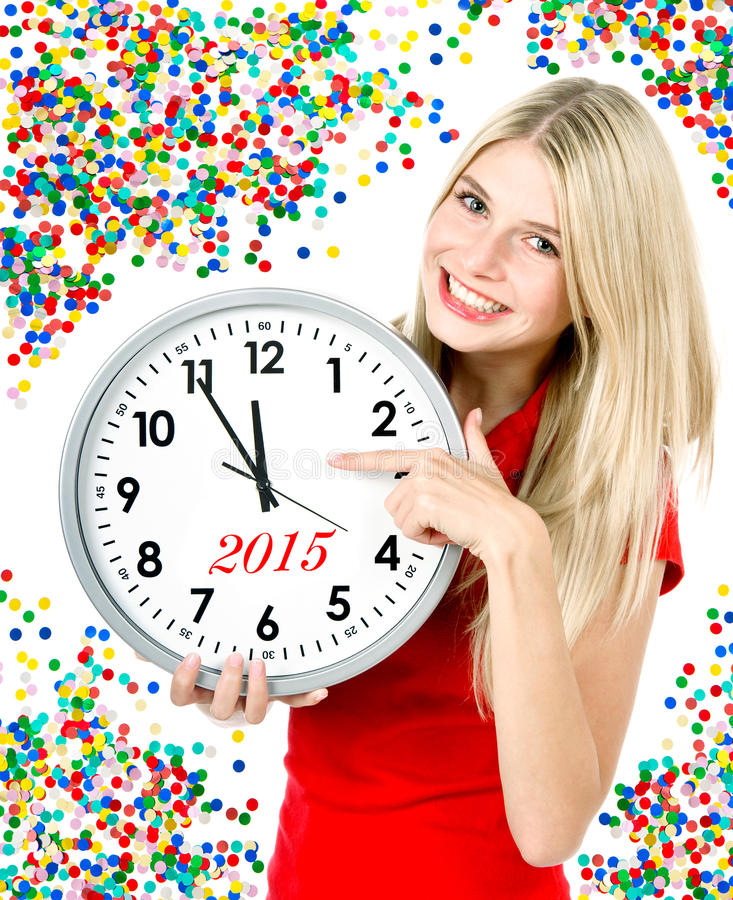 New year 2015. five to twelve. big clock and party decoration royalty free stock photography