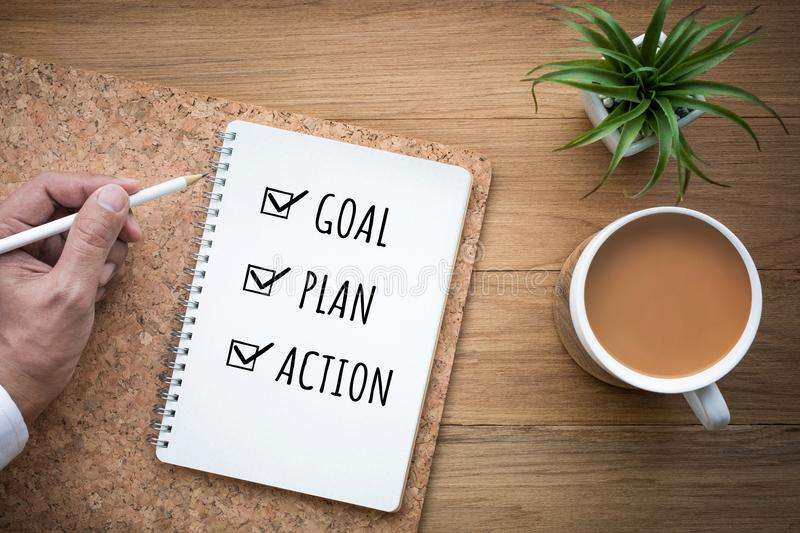 New year 2018 goal,plan,action text on notepad.Business motivation royalty free stock images