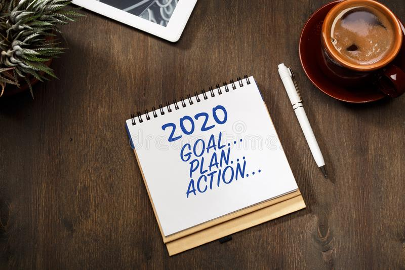 2020 new year goal, plan, action text on notepad. Business motivation, inspiration concepts royalty free stock photo