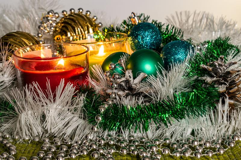 New year, green balls and decorations for the Christmas tree. Bright and beautiful scenery on a lemon background with white tinsel stock image