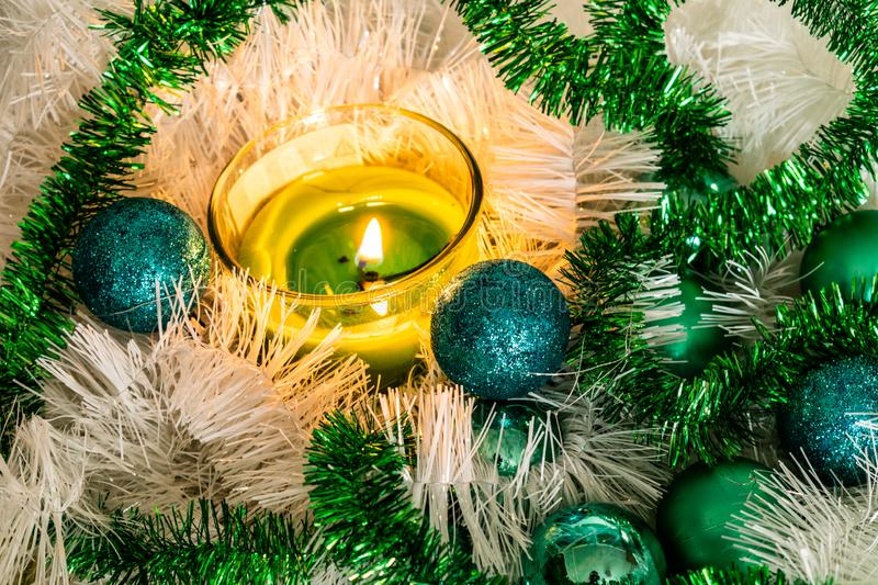 New year, green balls and decorations for the Christmas tree. Bright and beautiful scenery on a lemon background with white tinsel royalty free stock photo