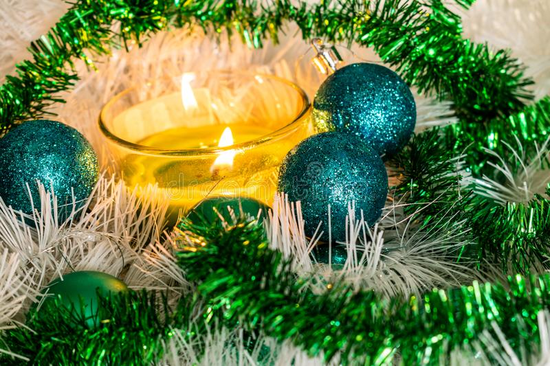 New year, green balls and decorations for the Christmas tree. Bright and beautiful scenery on a lemon background with white tinsel royalty free stock image