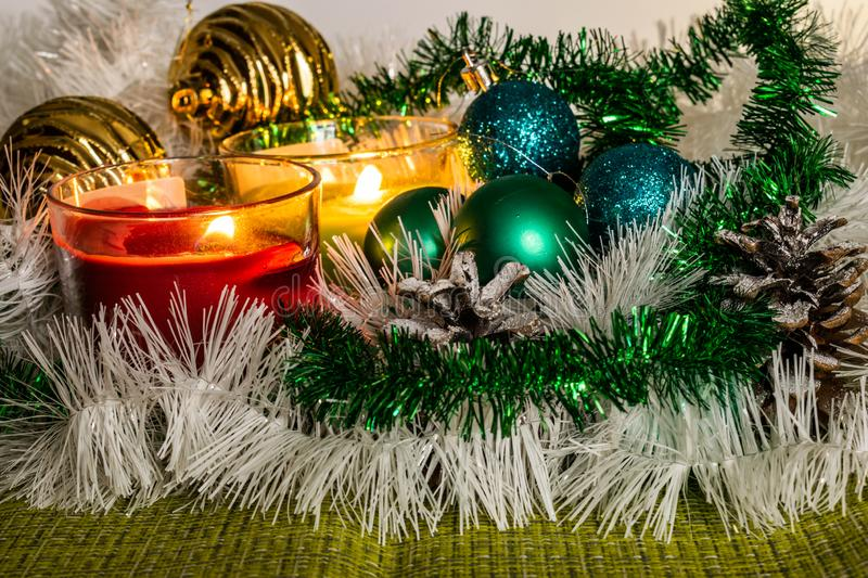 New year, green balls and decorations for the Christmas tree. Bright and beautiful scenery on a lemon background with white tinsel royalty free stock photos