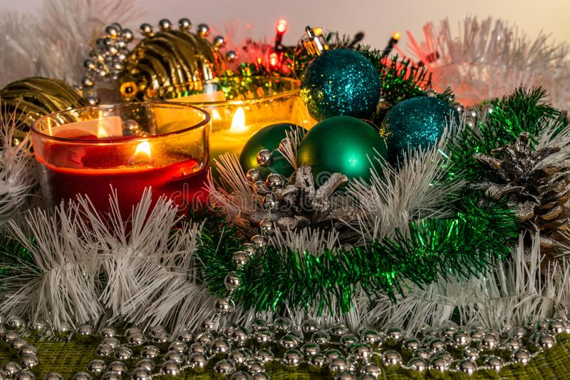 New year, green balls and decorations for the Christmas tree. Bright and beautiful scenery on a lemon background with white tinsel stock photos