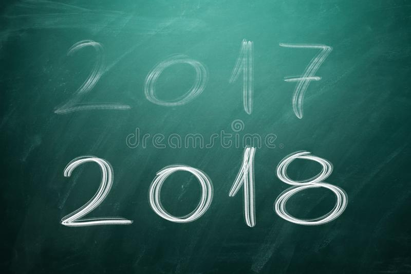 New year 2018 on green board. Chalkboard stock image