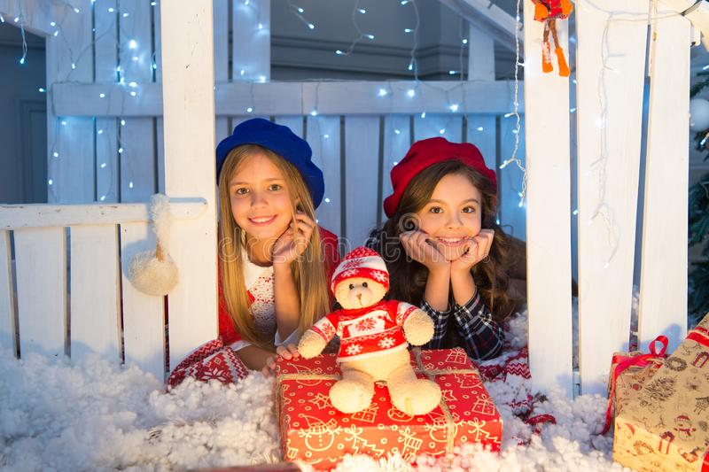 New Year greetings to all. Little children with toy and Christmas gifts. Happy children in house with Christmas. Decoration. Boxing day is the day after stock images