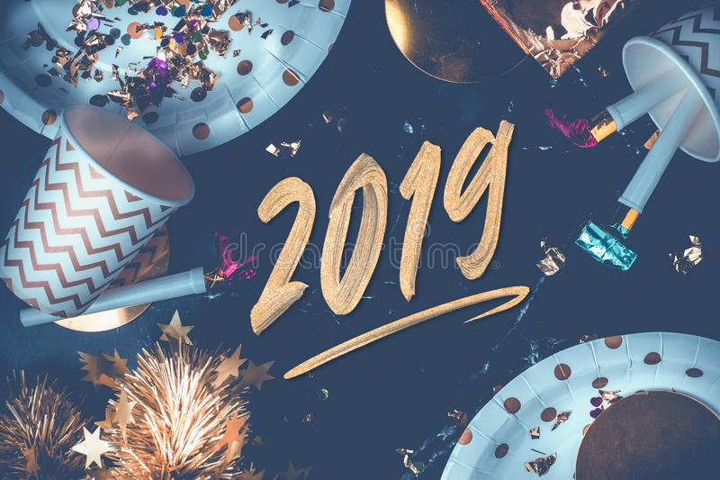 2019 new year hand brush storke font on marble table with party. Cup,party blower,tinsel,confetti.Fun Celebrate holiday party time table top view.blue modern stock images