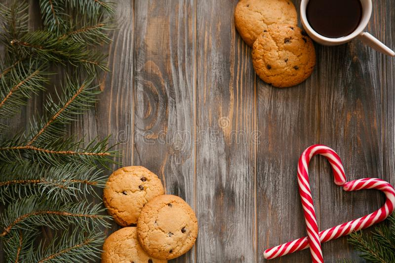 New year holiday decor coffee cookie candy cane royalty free stock photo