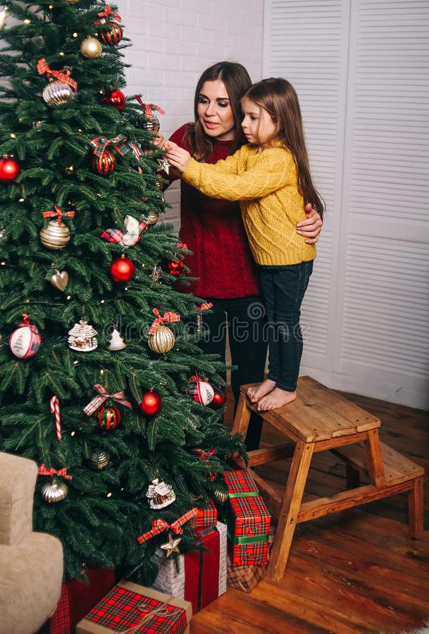 New year mom daughter decorate christmas tree royalty free stock photos