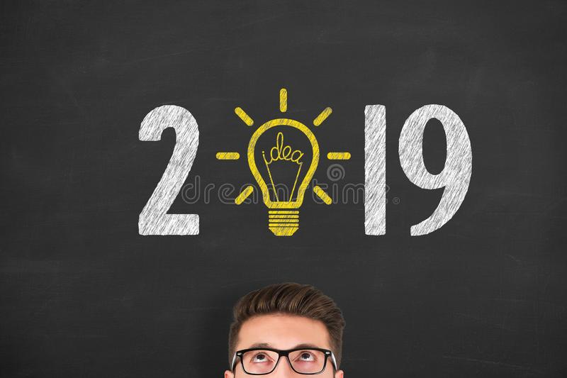 New Year 2019 Idea Concepts over Human Head on Blackboard Background. New Year 2019 Idea Concepts on Blackboard Background new year concepts royalty free stock photography