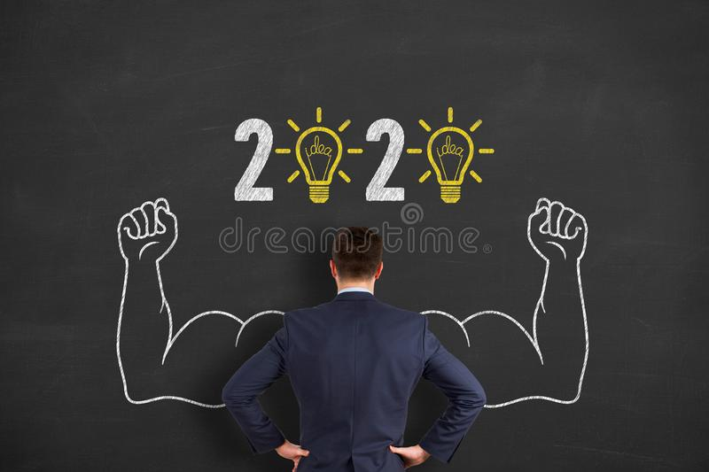 New Year 2020 Idea Concepts over Human Head on Blackboard Background. New Year 2020 Innovative Idea Concepts on Blackboard Background new year concepts stock image