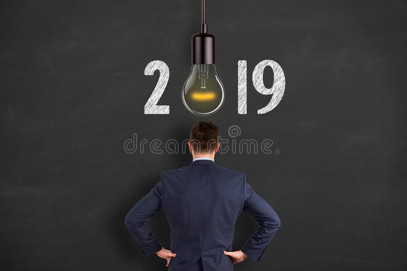 New Year 2019 Idea Concepts over Human Head on Blackboard Background. New year concepts royalty free stock photo