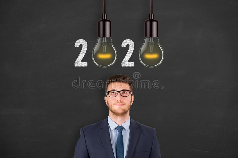 New Year 2020 Idea Concepts over Human Head on Blackboard Background. New year concepts royalty free stock photos