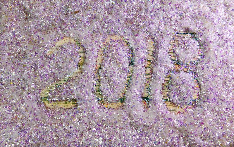 New Year inscription 2018 is written by a finger on brilliant beautiful artificial snow stock images