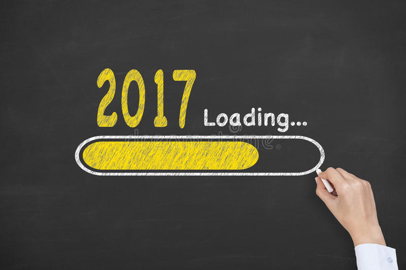 New Year 2017 Loading Technology on Blackboard Background royalty free stock images