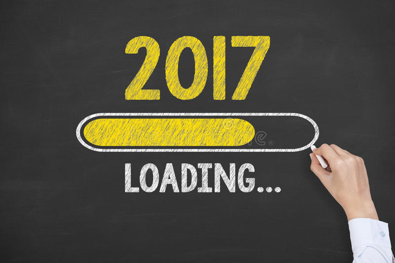 New Year 2017 Loading Technology on Chalkboard Background royalty free stock photography