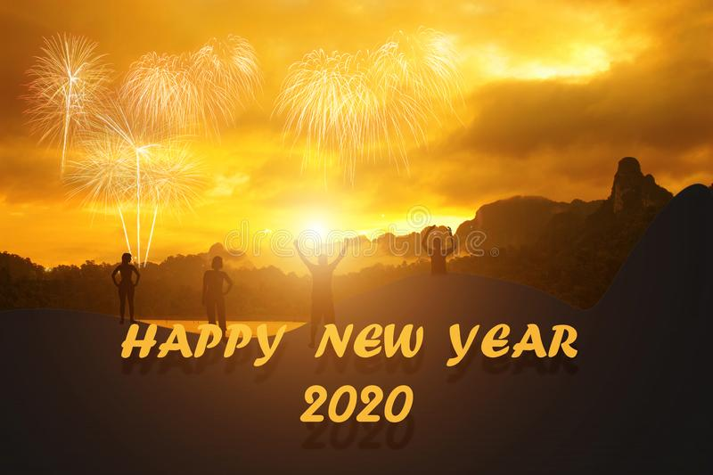 New year 2020 logo and Silhouette young people with sky background stock photos