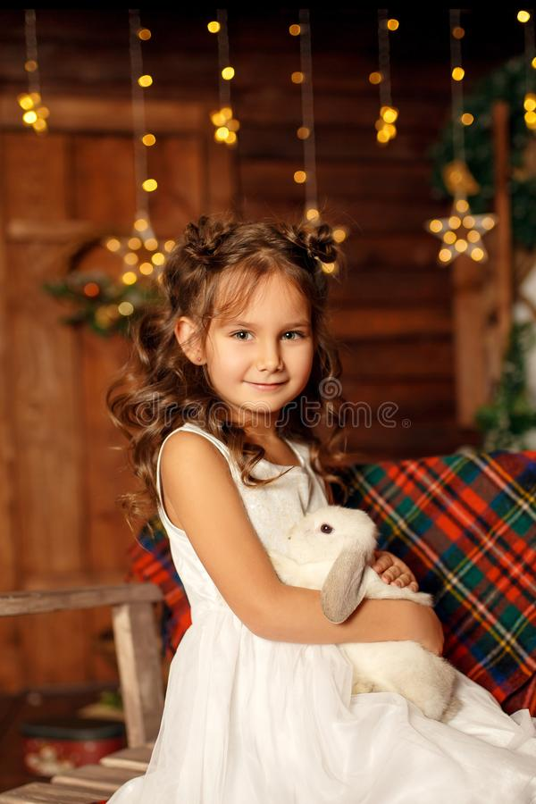 New Year 2020. Merry Christmas, happy holidays. Close-up portrait of a little girl Magic Light in Night Xmas Tree Interior.  royalty free stock photos