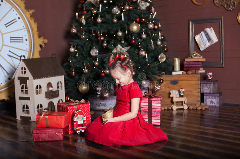 New Year 2020. Merry Christmas, happy holidays. Portrait of little girl with candle. Little girl holds a candle in her hands in fr royalty free stock photos