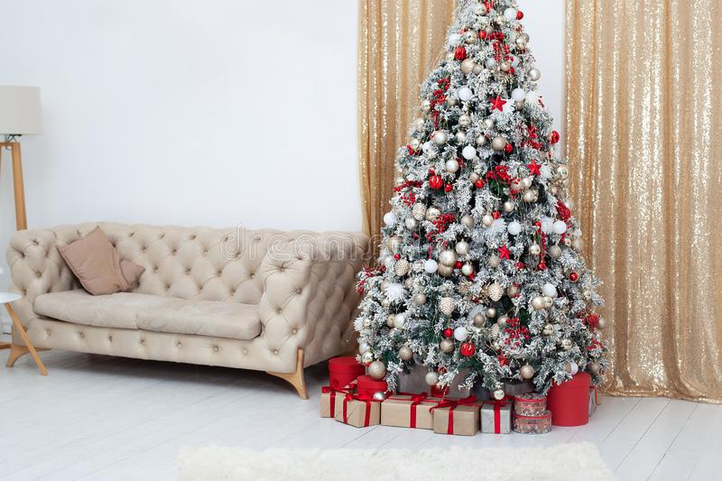 New Year. Merry Christmas and happy holidays. Stylish living room interior with decorated Christmas tree and comfortable sofa. Chr stock image