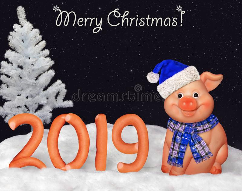 New Year 2019 with a merry pig 3. There is the number 2019 of the figures made from sausage on the snow in the forest. Merry Christmas. A pig is next to it royalty free stock photo
