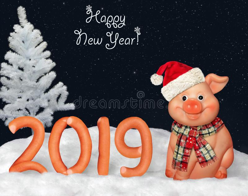 New Year 2019 with a merry pig 2. There is the number 2019 of the figures made from sausage on the snow in the forest. Happy New Year. A pig is next to it stock photo