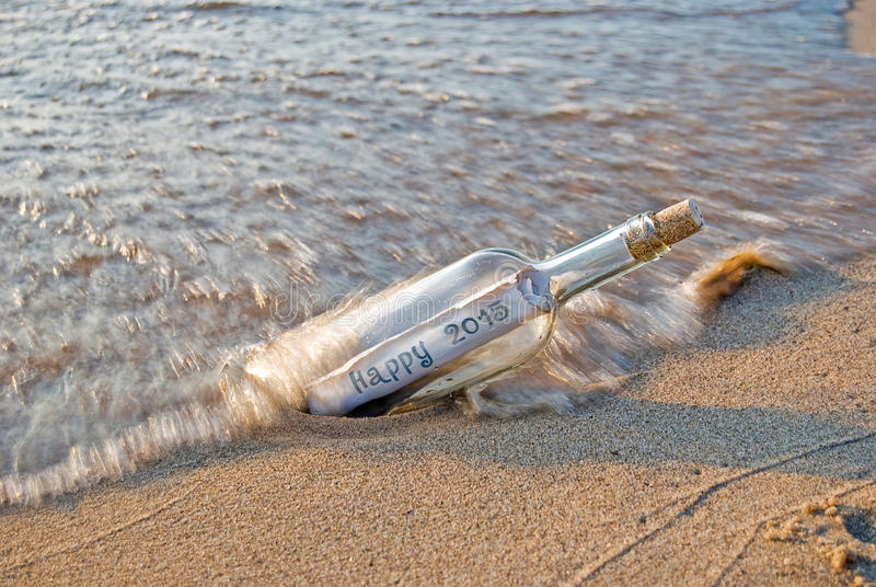New Year 2015 message in a bottle royalty free stock photo
